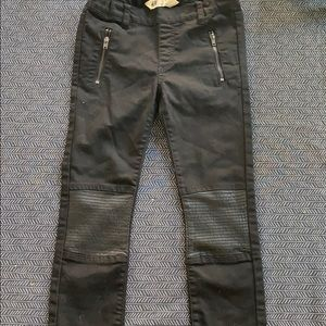 Black stretch toothpick jeans with moto patches